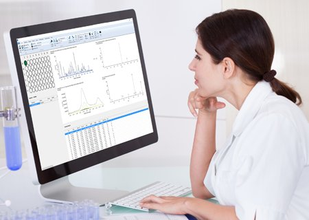 An image of woman using AnalyzerPro software in laboratory.